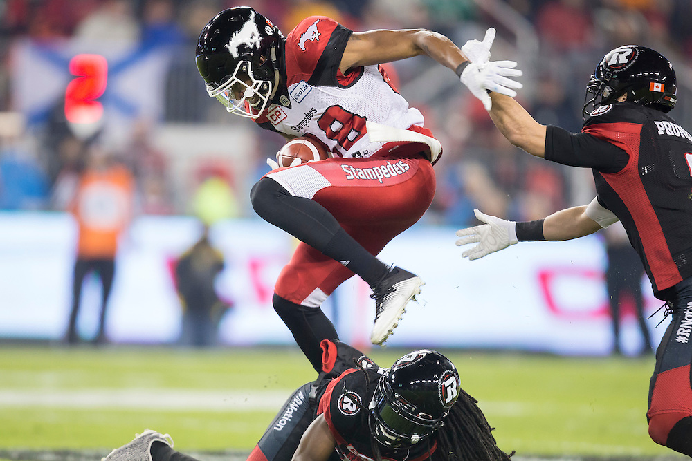 Kamar Jorden of the Calgary Stampeders runs the ball during the 1st quarter of the 104th Grey Cup against the Ottawa Redblacks in Toronto Ontario, Sunday,  November 27, 2016.  (CFL PHOTO - Geoff Robins)