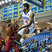 Delaware 87ers Guard Dustin Salisbery (14) drives to the basket as Fort Wayne Mad Ants Center Chris Hunter (32) defends in a NBA D-league regular season basketball game between the Delaware 87ers and The Fort Wayne Mad Ants Sunday, Dec. 15, 2013 at The Bob Carpenter Sports Convocation Center, Newark, DE
