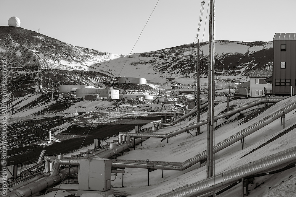 No underground utilities at McMurdo  because of the permafrost. Some (all?) of the large tanks in this photo have been converted into unheated storage.