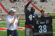 Kentrell Lockett (40) is presented the Chucky Mullins Courage Award by head coach Houston Nutt (left) and Phi Kappa Psi president Kory Keys in Mississippi's Grove Bowl in Oxford, Miss. on Saturday, April 17, 2010.