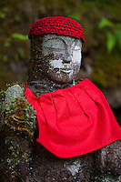 """Alternatively called Bake-jizo, Narabi-jizo (Jizos in a line) or Hyaku-jizo (100-Jizo), a group of mysteriously aligned Jizo patiently sit along the Daiya River and Jiunji Temple. """"Jizo"""" images and statues are popular in Japan as Bodhisattva who console beings awaiting rebirth and travelers. As such they are often found along roadsides, paths or even street corners. There is a group of about 70 Jizos along the Bake Jizo Trail in Nikko. At one time there were 100 jizos along this trail. However, some of those were washed away by flooding in 1902. Alternatively called Bake-jizo, Narabi-jizo (Jizos in a line) or Hyaku-jizo (100-Jizo), a group of mysteriously aligned Jizo patiently sit along the Daiya River and Jiunji Temple"""