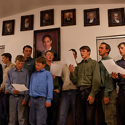 Members of the Fundamentalist Church of Jesus Christ Latter Day Saints congregate for their evening meeting of prayer and song in the dinning hall in Pioche, Nev., Aug. 14, 2009.  The Fundamentalist Church of Jesus Christ of Latter Day Saints is one of the largest Mormon fundamentalist denominations and one of United States' largest practitioners of plural marriage. The FLDS Church emerged in the early 1900s when its founding members left The Church of Jesus Christ of Latter-day Saints. The split occurred largely because of the LDS Church's renunciation of polygamy and its decision to excommunicate practitioners of plural marriage. Contact   Jim Jeffs at 325 315 3356.