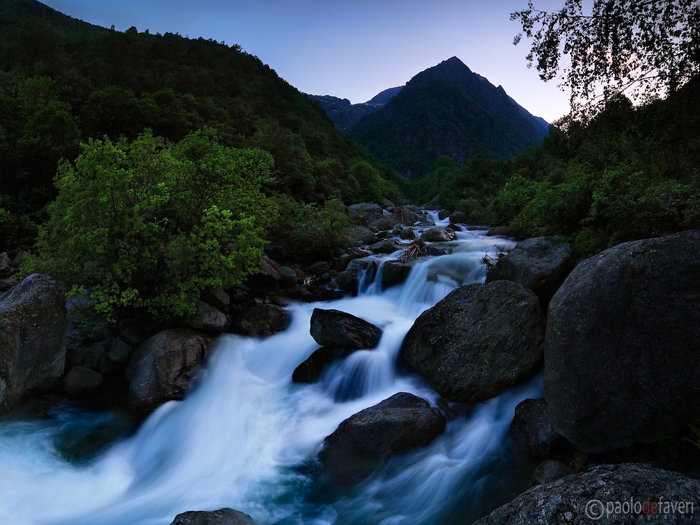 Playing with the coolness of the evening, the darkening shadows, and the last rays of the fading light in this moody representation of the Chiusella river gorges in Valchiusella, Piedmont, Italy. Taken about 45 minutes after sunset, this is stitched from four vertical frames.