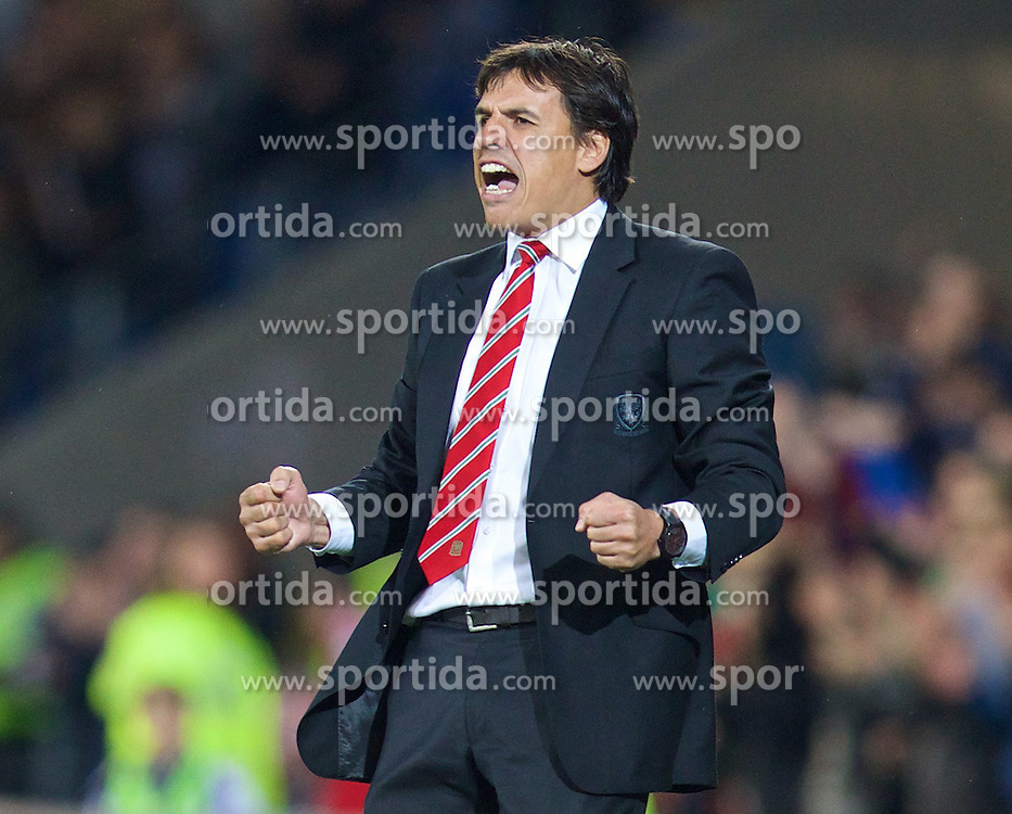 13.10.2014, City Stadium, Cardiff, WAL, UEFA Euro Qualifikation, Wales vs Zypern, Gruppe B, im Bild Wales' manager Chris Coleman celebrates the second goal against Cyprus // 15054000 during the UEFA EURO 2016 Qualifier group B match between Wales and Cyprus at the City Stadium in Cardiff, Wales on 2014/10/13. EXPA Pictures &copy; 2014, PhotoCredit: EXPA/ Propagandaphoto/ David Rawcliffe<br /> <br /> *****ATTENTION - OUT of ENG, GBR*****