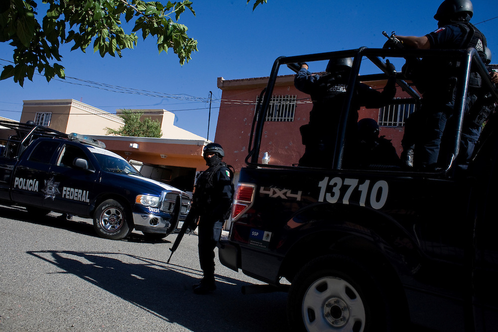 "Federal Police at the scene of a shootout which resulted in capturing one ""sicario"" or hit-man in Ciudad Juarez, Chihuahua on May 19, 2010."