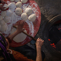 Making cheese-filled flatbreads in eastern Turkey.
