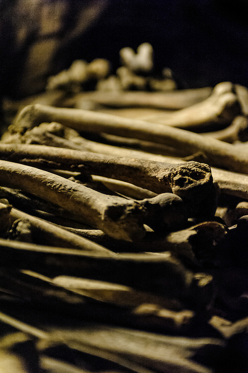 Stock photograph of bones in the Catacombs of Paris