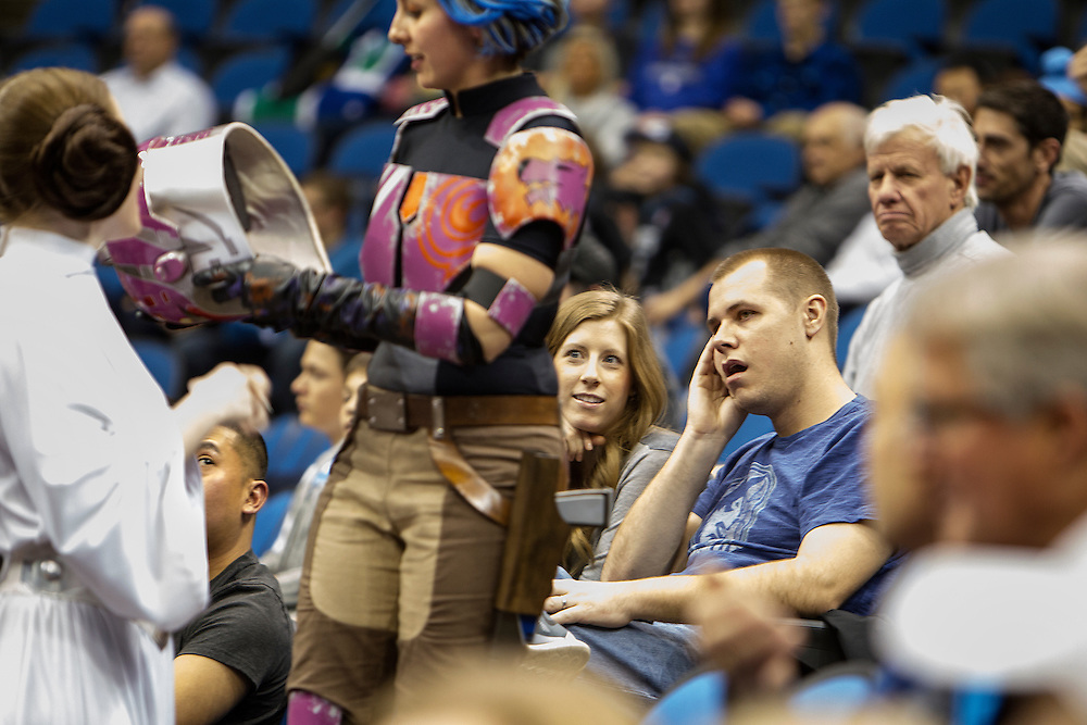 Jared Risan, right, and his wife Emily Risan of Bloomington watch Princess Leia (Lynn Sessions) and Sabine (Ashley Hay) as they make an appearance at Star Wars night at the Timberwolves game at Target Center in Minneapolis December 15, 2015.