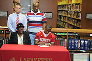 Lafayette High's Jeremiah Jones (26) signs a National Letter of Intent to play football at Holmes Community College, in Oxford, Miss. on Wednesday, February 1, 2012.