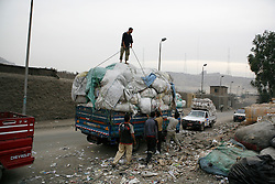 In the Moqattam area of greater Cairo live the Zabaleen, or garbage collectors. Mostly Coptic Christians from Upper Egypt, they came to Cairo in the 1950s in search of work. The Zabaleen are now responsible for collecting and recycling most of Cairo's waste. The waste is brought to Moqattam where it is sorted through and separated, most homes double as small factories where much of the family is involved in the process. They recycle plastic, glass, metal, paper, fabrics and just about everything else that Cairo's nearly 20 million people throw away each day. Discarded food is also separated and used as feed for animals, mostly pigs. The Egpytian government has threatened for decades to fully privatize the city's waste collection, which would threaten the livelihood of the tens of thousands of Moqattam Zabaleen.