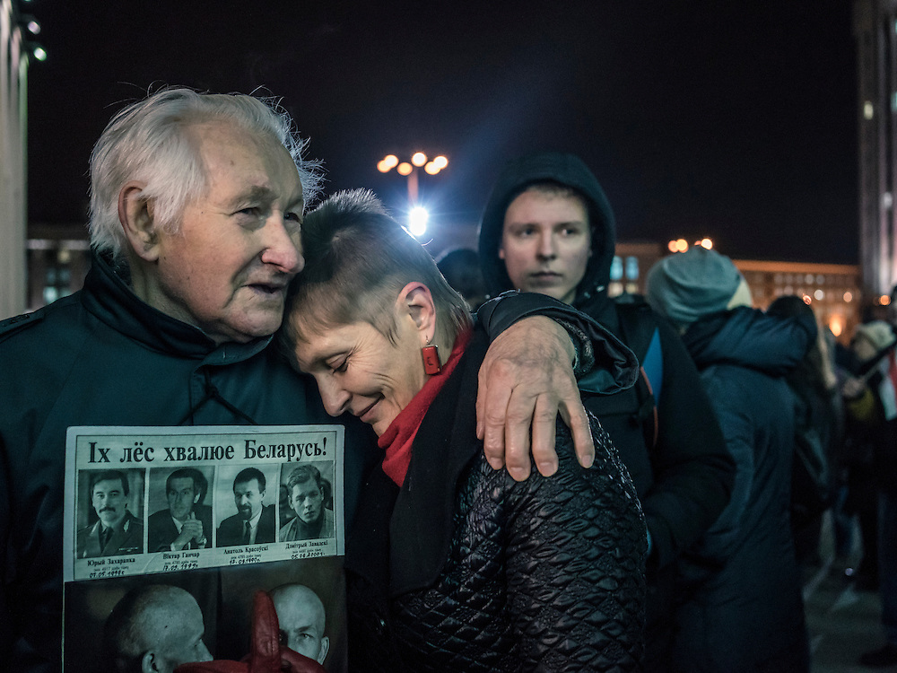 A man hugs the wife of Mikalai Statkevich, a former opposition presidential candidate and political dissident, after he was fined by police for organizing a rally to commemorate the nineteenth anniversary of a referendum which enshrined authoritarian changes in Belarus's constitution on Tuesday, November 24, 2015 in Minsk, Belarus.