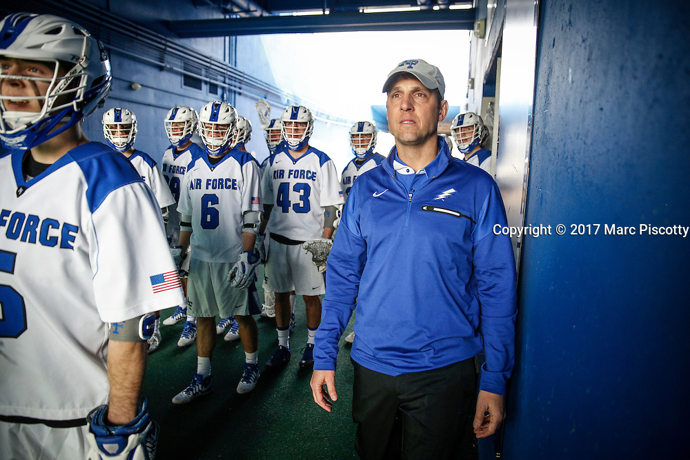SHOT 2/18/17 12:49:09 PM - Air Force head lacrosse coach Eric Seremet takes the field with his team before playing against Marist College at Falcon Stadium at the Air Force Academy in Colorado Springs, Co. Marist won the game 10-4. Seremet is in his ninth season as the head coach for the Air Force lacrosse program.<br /> (Photo by Marc Piscotty / &copy; 2017)
