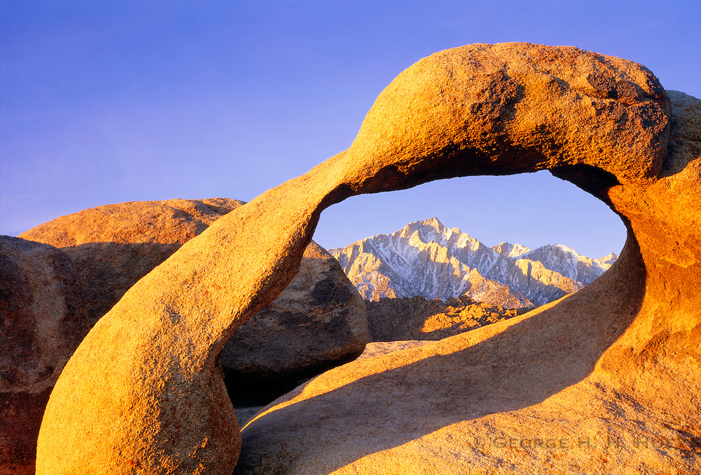 0671-1000 ~ Copyright: George H.H. Huey ~ Mt. Whitney and the Sierra Nevada Mountains, seen through a natural arch in the Alabama Hills at sunrise.  Eastern Sierra nevada, California.