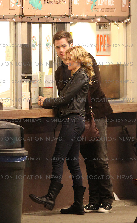 "January 27th, 2011 Los Angeles, CA. Non Exclusive. The first look at Chris Pine and Elizabeth Banks filming together for the dramatic movie ""Welcome To People"". Chris Pine arrived on set with his ipad before filming scenes with Elizabeth Banks all night outside in the chilly weather at the well known and highly regarded Henry's Taco Stand in The San Fernando Valley. Photo by Eric Ford/ On Location News 818-613-3955 info@onlocationnews.com"