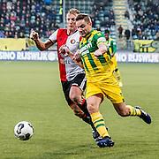 DEN HAAG - ADO Den Haag - Feyenoord , Voetbal , Eredivisie , Seizoen 2016/2017 , Kyocera Stadion , 19-02-2017 , Feyenoord speler Dirk Kuyt (l) in duel met ADO Den Haag speler Aaron Meijers (r)