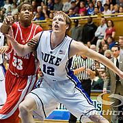 21 November 2009: Duke Junior Forward #12 Kyle Singler blocks out Radford (33) Jamal Curry freshman forward..Duke Rolls Past Radford 104-67 .Mandatory Credit: Mark Abbott / Southcreek Global