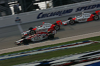 Dan Wheldon takes the checkered flag ahead of Helio Castroneves and Sam Hornish Jr.  Chicagoland Speedway,<br />September 11, 2005