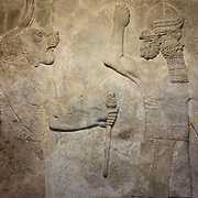 Detail in the British Museum of an Assyrian relief. Assyrian kings competed to outdo each other with carved reliefs on interior walls. This tradition began with King Ashurnasirpal II (reigned 883-859BC) at Nimrud. In 612BC Assyrian cities were looted and destroyed by Babylonians and Medes and the sculptures were buried until discovered by British and French archaeologists in the 19th century. As a result, London and Paris have the largest collection of Assyrian reliefs outside Iraq.