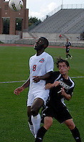Ohio State midfielder Chris Hegngi (9) fights for possession against Binghamton midfielder Tommy Moon (7) as OSU takes on Binghamton in the first half of an NCAA men's college soccer game in Columbus, Ohio on Sunday, Sept. 11, 2011, at Jesse Owens Memorial Stadium.