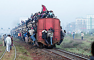 Kenyans pack a Nairobi bound railroad train on Tuesday morning, February 3, 2004. Thousands of Kenyans are affected by a limited numbered of matatus, buses and mini-buses on Kenya's roadways, as strict vehicle transportation safety laws went into effect.