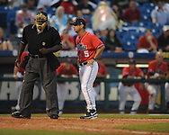 Ole Miss Head Coach Mike Bianco talks with home plate umpire Randy Harvey during the Southeastern Conference tournament at Regions Park in Hoover, Ala. on Friday, May 28, 2010.  (AP Photo/Oxford Eagle, Bruce Newman)