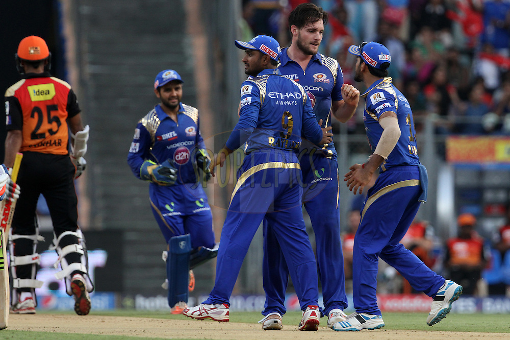 Mumbai Indians players celebrates the wicket Sunrisers Hyderabad captain Shikhar Dhawan during match 23 of the Pepsi IPL 2015 (Indian Premier League) between The Mumbai Indians and The Sunrisers Hyderabad held at the Wankhede Stadium in Mumbai India on the 25th April 2015.<br /> <br /> Photo by:  Vipin Pawar / SPORTZPICS / IPL