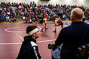 Christian Price is focused only on getting to the state championship this year. He kept up his training during the off season, goes to open mats with wrestler from other schools and is team captain. Before his third match of the day, he talks with his father, Hugh Price, who was also keeping score for the day.