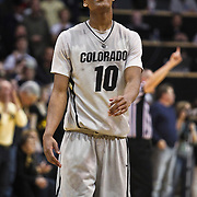SHOT 2/26/11 5:16:42 PM - Colorado's Alec Burks (#10) flashes a smile as time winds down against Texas during their regular season Big 12 basketball game at the Coors Events Center in Boulder, Co. Colorado upset the fifth ranked Texas 91-89. Burks scored 33 points in the win. (Photo by Marc Piscotty / © 2011)