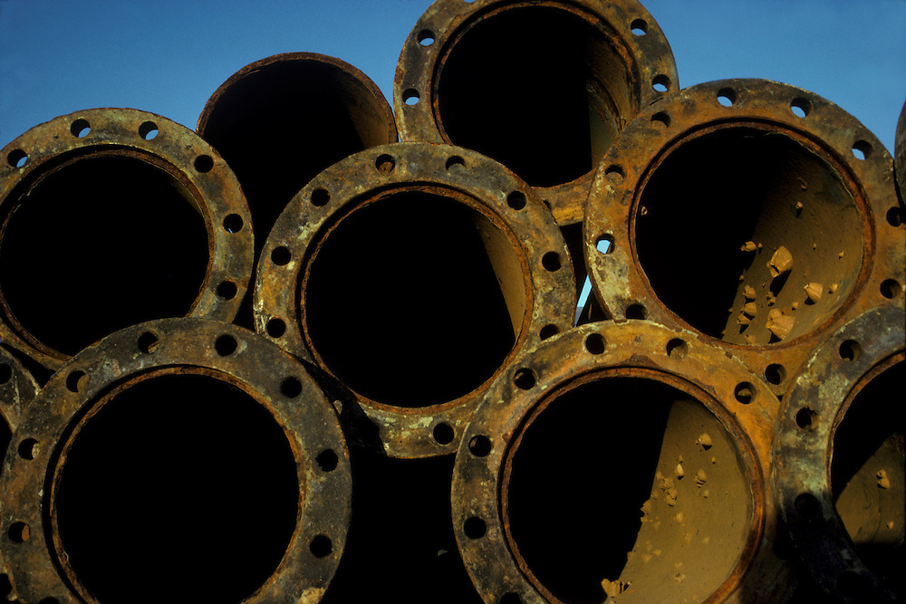 Stack of Pipe flanges against a blue sky at the Houston Ship Channel, Texas.