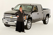 ROYAL OAK, MICHIGAN - OCTOBER 12: Candace Haag, who was the first woman director of truck advertising in the automobile industry, poses with a Chevy Silverado pickup truck in Royal Oak, MI, Wednesday, October 12, 2011.  (Jeffrey Sauger)