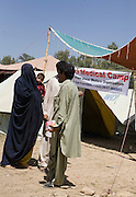 Residents from SWAT valley begin arriving at Shaik Yaseen IDP camp at outside of Mardan in North West Frontier Province, Pakistan...More than 1400 families have reportedly registered as IDP's seeking shelter and food at the hastily arranged camp. According to UNHCR Some 500,000 residents have fled SWAT and neighboring provinces since August 2008. Last Thursday the Pakistan Government announced a military operation to 'eliminate' Taliban militants form the SWAT Valley. A further 1 million IDp are expected in the coming weeks as the military advances throughout SWAT valley towards achieving their military goals...