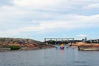Kayaker in Narrow passage, Hvaler, Østfold - kajakkpadler gjennom smal kanal på Hvaler, Østfold, Oslofjorden