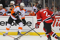 Mar 13, 2013; Newark, NJ, USA; Philadelphia Flyers right wing Scott Hartnell (19) looks to pass the puck while being defended by New Jersey Devils defenseman Marek Zidlicky (2) during the second period at the Prudential Center.