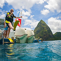 A diver makes a giant stride entry into the Caribbean waters in St. Lucia.
