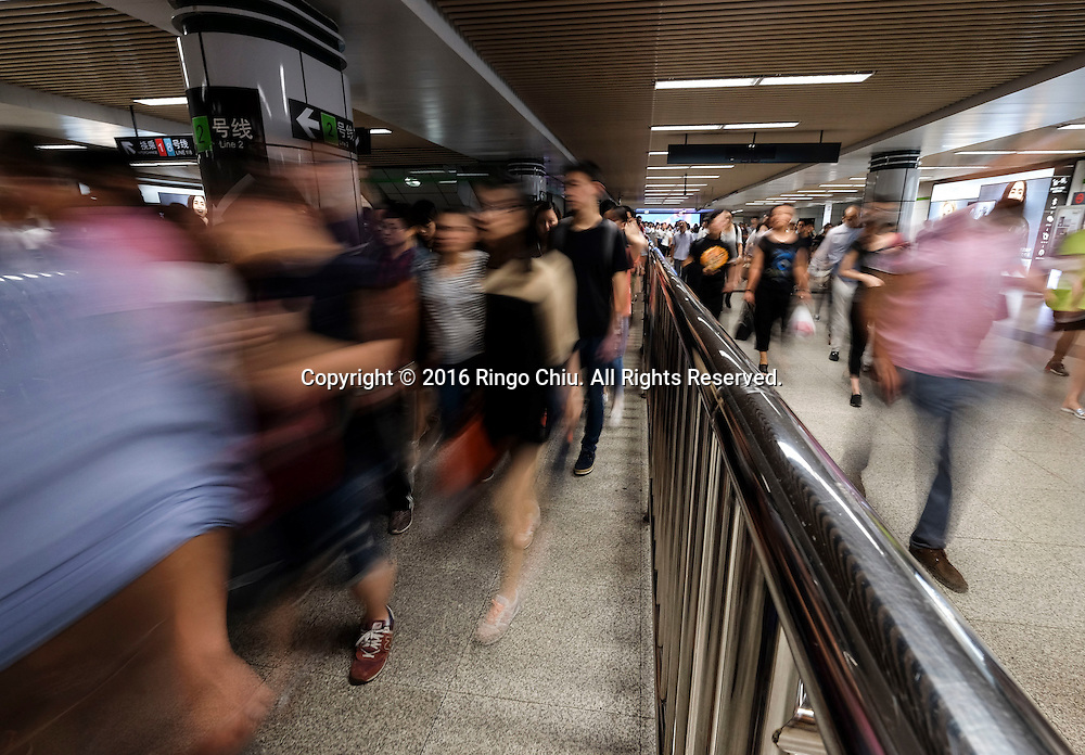 People rush to work and school at subway station on Monday morning in Shanghai, China. Shanghai is the most populous city in China and the most populous city proper in the world. It is one of the four direct-controlled municipalities of China, with a population of more than 24 million as of 2014. It is a global financial centre, and a transport hub with the world's busiest container port. Located in the Yangtze River Delta in East China, Shanghai sits on the south edge of the mouth of the Yangtze in the middle portion of the Chinese coast. The municipality borders the provinces of Jiangsu and Zhejiang to the north, south and west, and is bounded to the east by the East China Sea. A major administrative, shipping, and trading town, Shanghai grew in importance in the 19th century due to trade and recognition of its favourable port location and economic potential. The city was one of five forced open to foreign trade following the British victory over China in the First Opium War while the subsequent 1842 Treaty of Nanking and 1844 Treaty of Whampoa allowed the establishment of the Shanghai International Settlement and the French Concession. The city then flourished as a center of commerce between China and other parts of the world (predominantly Western countries), and became the primary financial hub of the Asia-Pacific region in the 1930s. However, with the Communist Party takeover of the mainland in 1949, trade was limited to socialist countries, and the city's global influence declined. In the 1990s, the economic reforms introduced by Deng Xiaoping resulted in an intense re-development of the city, aiding the return of finance and foreign investment to the city. Shanghai has been described as the &quot;showpiece&quot; of the booming economy of mainland China; renowned for its Lujiazui skyline, museums and historic buildings, such as those along The Bund, the City God Temple and the Yu Garden.(Photo by Ringo Chiu/PHOTOFORMULA.com)<br /> <br /> Usage Notes: This con
