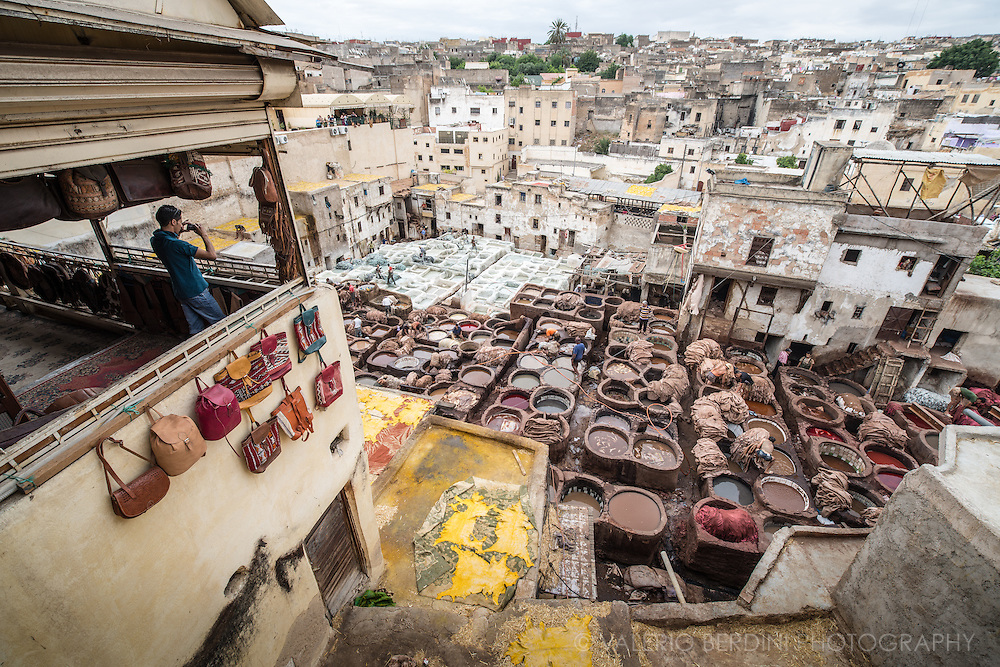 A boy shooting from an advatageous point overlooking Chouara tannery in Fez. This is a full working tannery that has been working relentlessly for more than thousand years