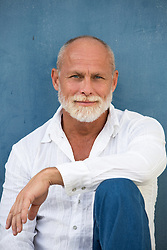 portrait of a handsome mature man with blue eyes and a white beard