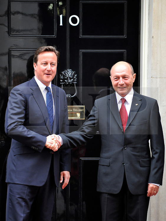 © licensed to London News Pictures. LONDON, UK.  06/06/11. British Prime Minister greets Romanian President Traian Basescu on Downing Street today, 6th June 2011.  Photo credit should read Stephen Simpson/LNP