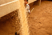 Hassan Hamed spreads new sand in a filter at the al-Wathba water treatment plant in Baghdad.