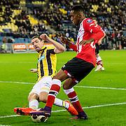 ARNHEM - Vitesse - PSV , Voetbal , Eredivisie , Seizoen 2016/2017 , Gelredome , 29-10-2016 ,  Vitesse speler Arnold Kruiswijk (l) in duel met PSV speler Florian Jozefzoon (r)