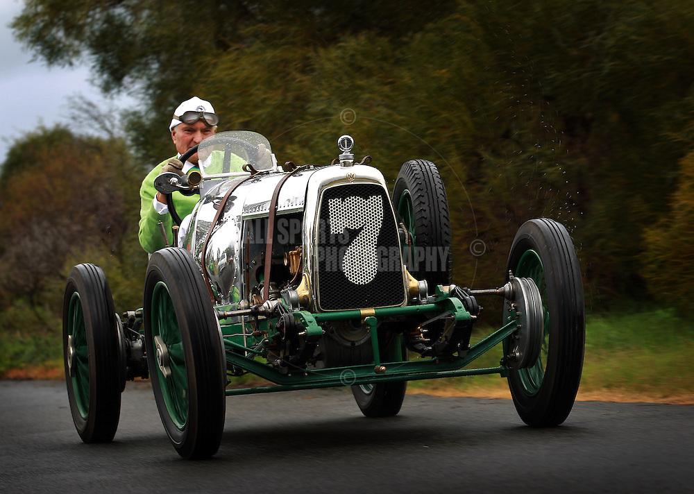 PERTH, AUSTRALIA - JUNE 19: Peter Briggs drives his 1923 Aston Martin on June 19, 2012 in Perth, Australia. (Photo by Paul Kane)
