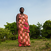 "Pognaa Napog Kpintaatobo I on the edge of her village of Baazing in the Upper West region of Ghana on 26 June 2105. A pognaa is responsible, in particular, for the wellbeing of women and children in her area of authority. While the title translates as ""woman chief"", in practice her authority is  subject to a male chief. The role of the pognamine (plural of pognaa) is being revived after having been suppressed during the colonial era, and they are increasingly seen as a force for development."