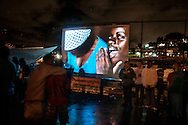 Baile Funk in the favela Arvore Seca, in the district of Lins, Rio de Janeiro. On thescreen, a slideshow of Vincent Rosenblatt's photos. After years documenting Baile Funk in the whole city - he started to show it back in the place where the work was done.