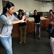 Exiled Tibetan students in a class in Tibetan dance at TIPA, the Tibetan Institute for the Performing Arts. Dharamsala, India. TIPA's mission is to provide an education in Tibetan performing arts to a generation of Tibetan youth growing up in exile in India. 7/28/05.