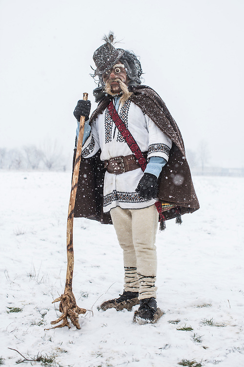 Ivan Iliuts, 45, dressed in the costume of an old man, poses for a portrait during celebrations of the Malanka Festival on Thursday, January 14, 2016 in Krasnoilsk, Ukraine. The annual celebrations, which consist of costumed villagers going in a group from house to house singing, playing music, and performing skits, began the previous sundown, went all night, and will last until evening. According to tradition, married men are only able to take part in Malanka wearing a mask.