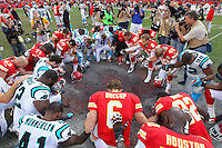 Kansas City kicker Ryan Succop (6) leads other players in a prayer for Chiefs linebacker, Jovan Belcher, following their NFL football game at Arrowhead Stadium in Kansas City, Mo., Sunday, Dec. 2, 2012. Belcher killed himself after murdering his girlfriend on Saturday. (AP Photo/Colin E. Braley)