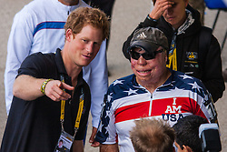 Queen Elizabeth Olympic Park, London. September 13th 2014. Prince Harry chats with Technical Sergeant Israel Del Toro, the first 100% disabled serviceman to re-enlist in the US Air Force, and who is competing in athletics, cycling, powerlifting and seated volleyball as wounded servicemen and women from 13 different countries compete for sporting glory during the cycling competition at the Invictus Games.
