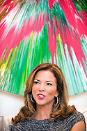 UK. London. Heather, wife of Billionaire Hotel owner Sol Kerzner in his luxury home in Holland Park, West London. Behind her is a Damien Hirst painting.