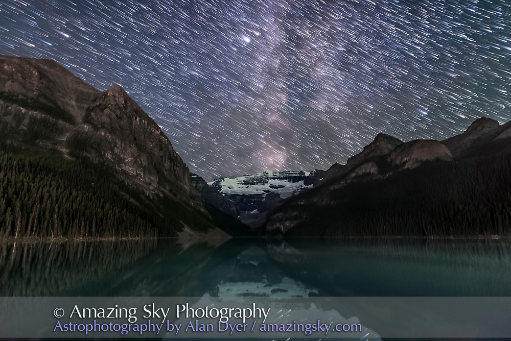 A composite of images stacked to create star trails descending over Lake Louise and Victoria Glacier in Banff National Park, Alberta, August 29, 2016. The Milky Way forms the bright band and the bright star at top is Altair. <br /> <br /> The sky comes from about 100 frames stacked with a Lighten mode blend to create the star trails, while the ground comes from a stack of 8 images averaged to smooth noise. A msater dark frame was applied to reduce discoloration. Each exposure was 10 seconds at f/1.6 with the Sigma 20mm lens and Nikon D750 at ISO 6400. The frames were shot as part of a 300-frame time-lapse sequence.