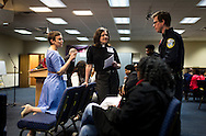MILWAUKEE, WI – MARCH 28: Zeidler Center Executive Director Dr. Katherine Wilson, left, Redeemer Lutheran Church pastor Lisa Froiland, and Milwaukee Police Officer Cullin Weiskopf, right, talk before the Harambee neighborhood Police and Resident Discussion event on Monday, March 28, 2016.